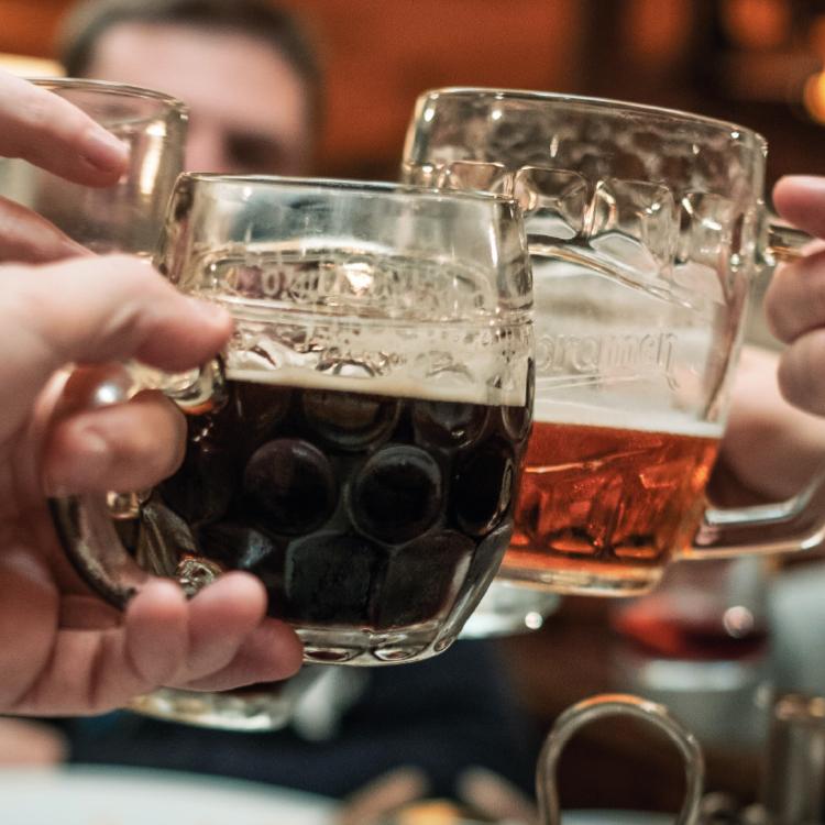 image of people cheersing with beer